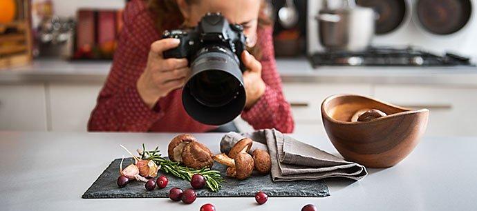 woman-food-photographer-taking-closeup-of-mushrooms