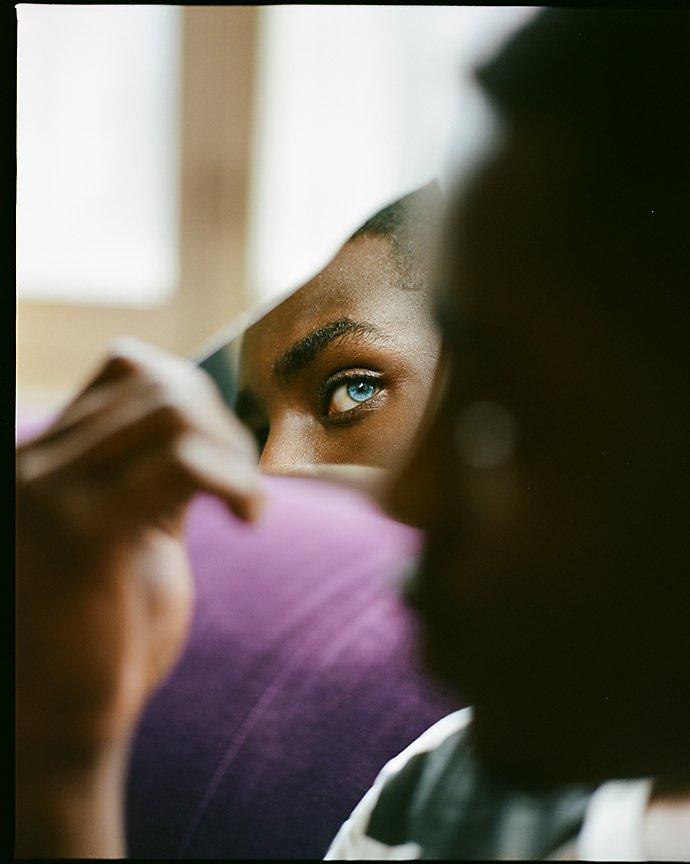 Photographer shooting a portrait of a fashion model
